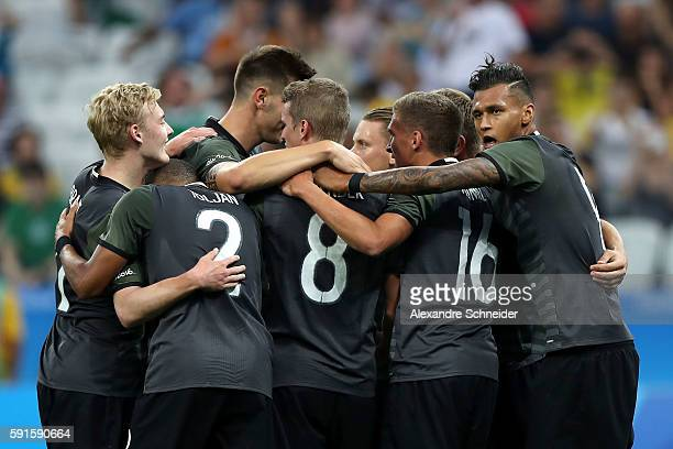 Nils Petersen of Germany celebrates scoring a goal with team mates during the Men's Semifinal Football match between Nigeria and Germany on Day 12 of...