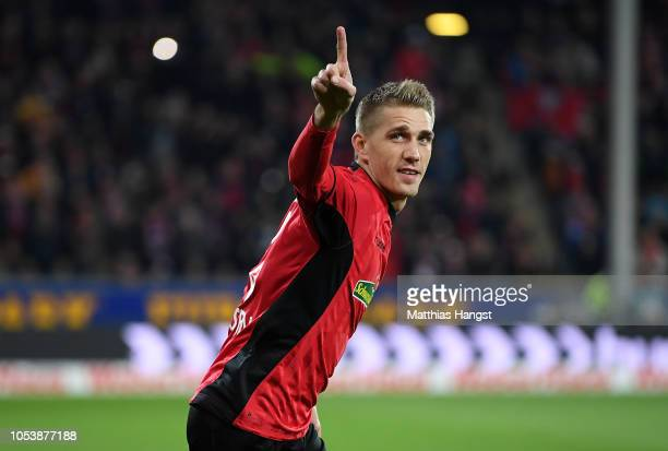 Nils Petersen of SC Freiburg celebrates scoring his side's opening goal from the penalty spot during the Bundesliga match between SportClub Freiburg...
