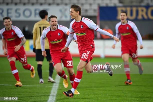 Nils Petersen of SC Freiburg celebrates with teammates after scoring their team's second goal during the Bundesliga match between Sport-Club Freiburg...