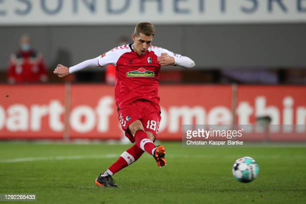 Nils Petersen of SC Freiburg scores their team's fourth goal from a penalty during the Bundesliga match between Sport-Club Freiburg and Hertha BSC at...