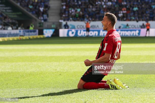 Nils Petersen of Sport-Club Freiburg celebrates after scoring his team's third goal during the Bundesliga match between TSG 1899 Hoffenheim and...