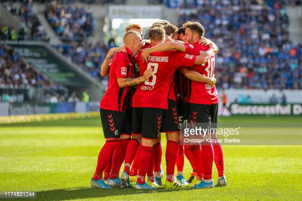 Nils Petersen of Sport-Club Freiburg celebrates with teammates after scoring his team's third goal during the Bundesliga match between TSG 1899...