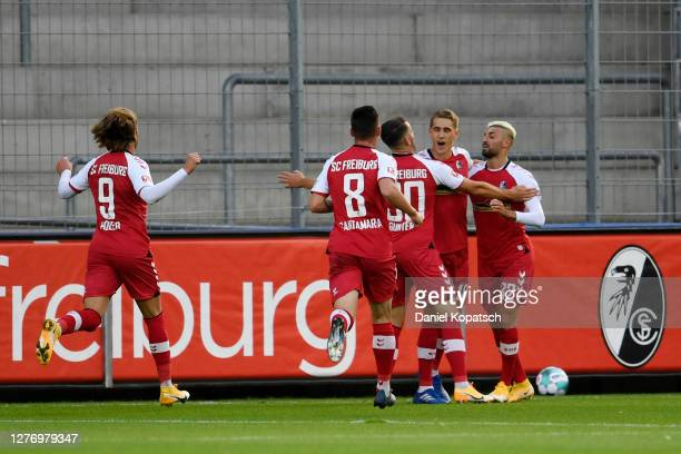 Nils Petersen of Sport-Club Freiburg celebrates with teammates after scoring his sides first goal during the Bundesliga match between Sport-Club...
