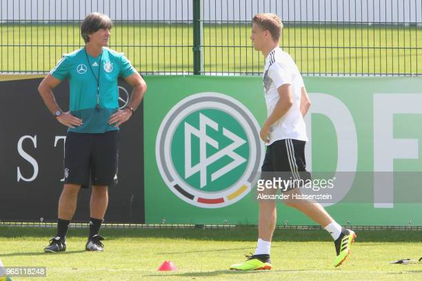 Nils Petersen runs next to Joachim Loew head coach of the German national team during a training session of the German national team at Sportanlage...