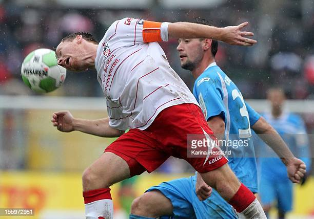Nils PfingstenReddig of Erfurt challenges Maik Kegel of Chemnitz during the Third League match between RW Erfurt and Chemnitzer FC at Steigerwald...