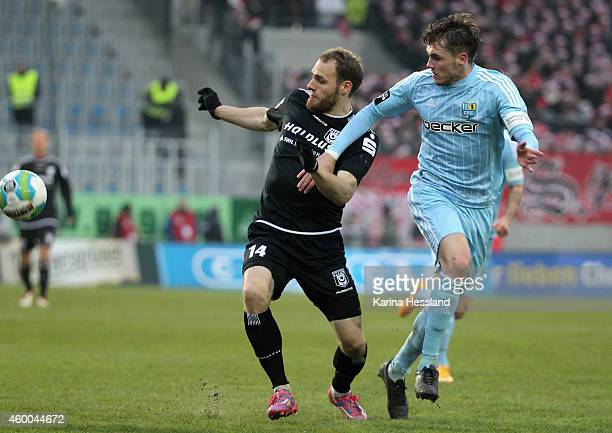 Nils Roeseler of Chemnitz challenges Timo Furuholm of Halle during the 3Liga match between Chemnitzer FC and Hallescher FC at Stadion an der...