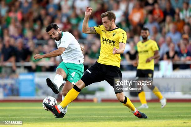 Nils Roeseler of Venlo challenges Claudio Pizarro of Bremen during the Pre Season Friendly Match between VVV Venlo and Werder Bremen at...