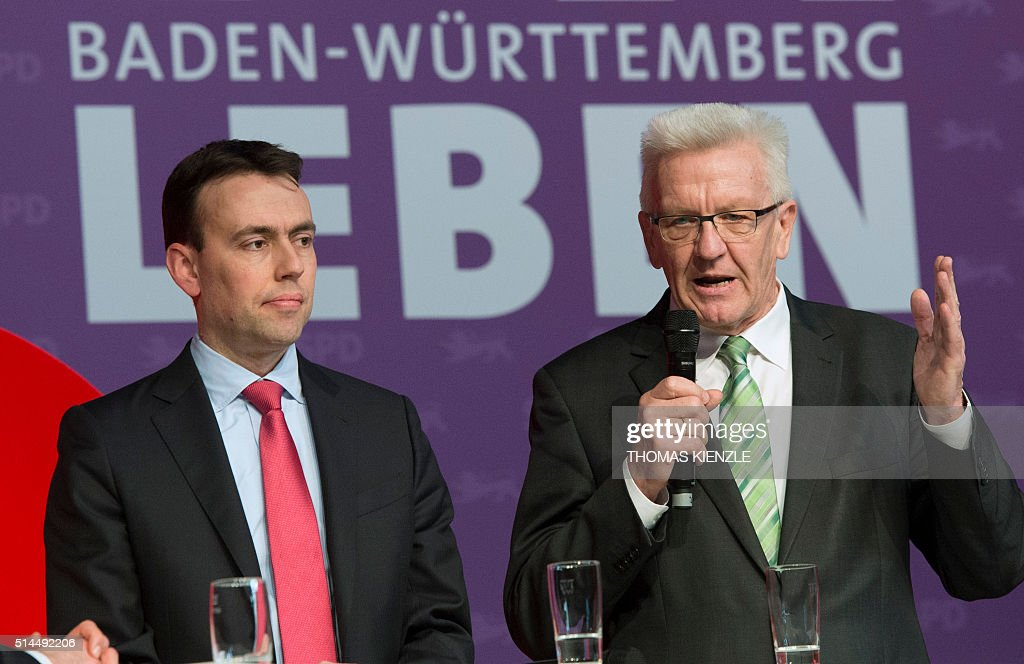 Nils Schmid (L), top candidate of the German Social Democratic Party (SPD) for the state elections in German state Baden-Wuerttemberg, and Winfried Kretschmann, top candidate of the Greens (Buendnis90/ Die Gruenen) and current state premier, attend an election campaign event in Karlsruhe, southwestern Germany, on March 9, 2016. The state election will be held on March 13, 2016. / AFP / THOMAS