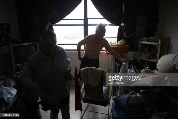 Nilsa Gonzalez and Carlo Gonzalez live in their dark apartment as they and other residents of the 62 and over Moradas Las Teresas's Uno and Dos condo...
