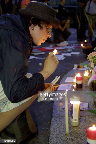 Nilsa Olivero lights a candle in Union Square in New York 11 October 2001 Mourners gathered in the park on the one month anniversary of the terrorist...