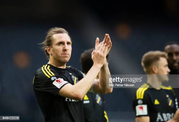NilsEric Johansson of AIK celebrates after the victory during the Alllsvenskan match between AIK and Halmstad BK at Friends Arena on September 16...