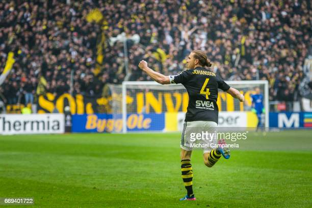 NilsEric Johansson of AIK celebrates scoring the opening goal during an Allsvenskan match between AIK and Hammarby IF at Friends arena on April 17...