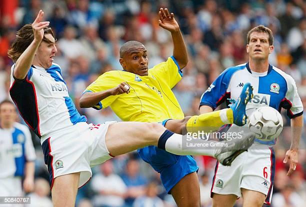 NilsEric Johansson of Blackburn battles with Clinton Morrison of Birmingham during the FA Barclaycard Premiership match between Blackburn Rovers and...