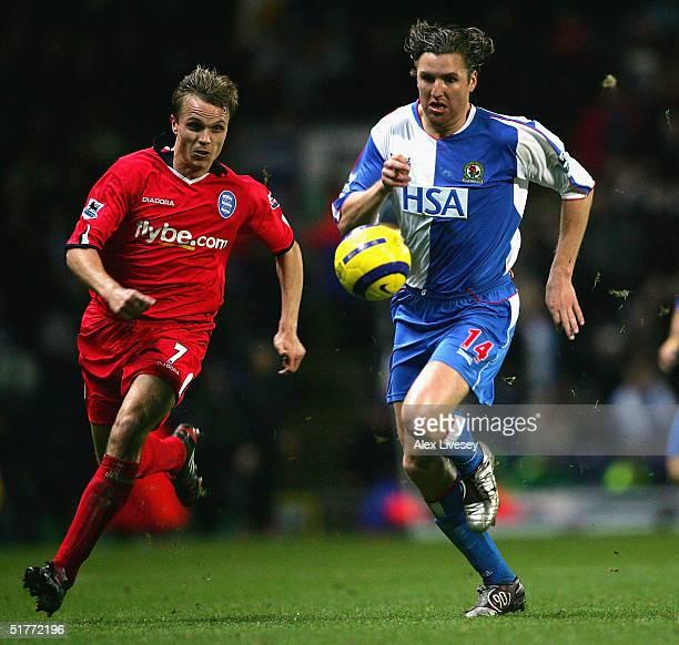 NilsEric Johansson of Blackburn Rovers beats Jesper Gronkjaer of Birmingham City during the Barclays Premiership match between Blackburn Rovers and...