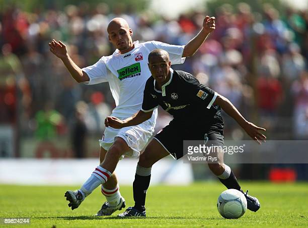 NilsOle Book of Ahlen and Sidney Sam of Lautern battle for the ball during the second Bundesliga match between RotWeiss Ahlen and 1 FC Kaiserslautern...