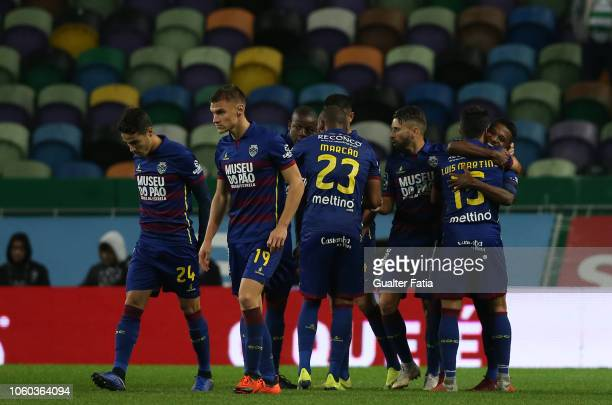 Niltinho of GD Chaves celebrates with teammates after scoring a goal during the Liga NOS match between Sporting CP and GD Chaves at Estadio Jose...