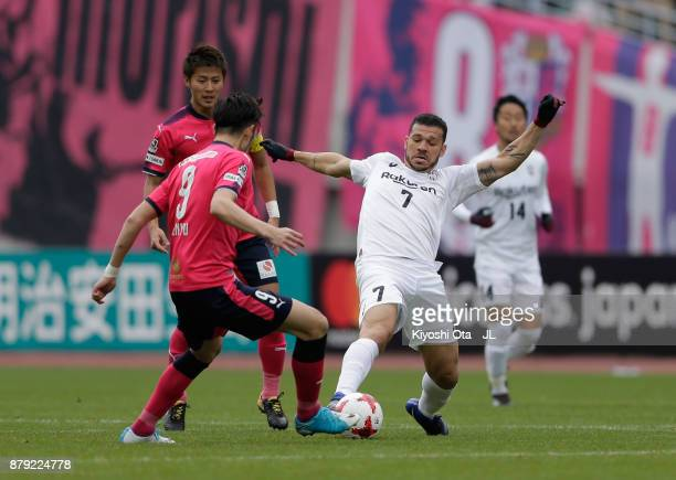 Nilton of Vissel Kobe and Kenyu Sugimoto of Cerezo Osaka compete for the ball during the JLeague J1 match between Cerezo Osaka and Vissel Kobe at...