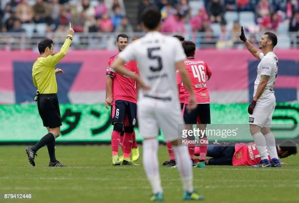 Nilton of Vissel Kobe is shown a yellow card by referee Hiroyuki Kimura during the JLeague J1 match between Cerezo Osaka and Vissel Kobe at Yanmar...