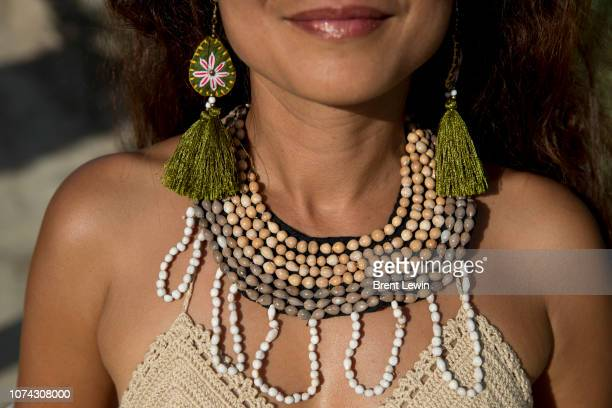 Nim wearing a necklace made from an Akha hill tribe village in Northern Thailand at Wonderfruit 2018 on December 16 2018 in Pattaya Thailand