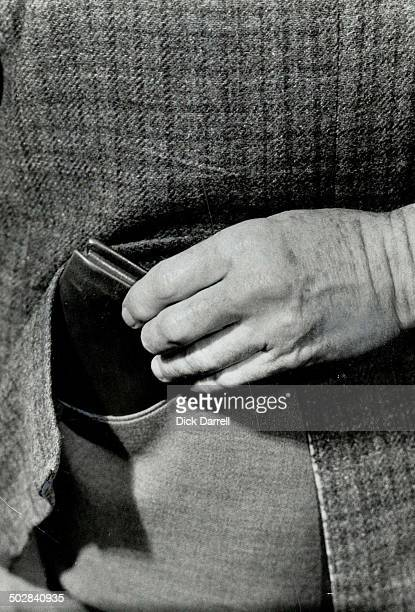 Nimblefingered pickpocket gently lifting a wallet from pocket