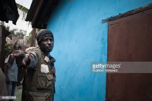 Nimery Matar Jamous aka Force the leader of the main selfdefence group in PK5 stands in a compound of his base in the PK5 district of Bangui on April...