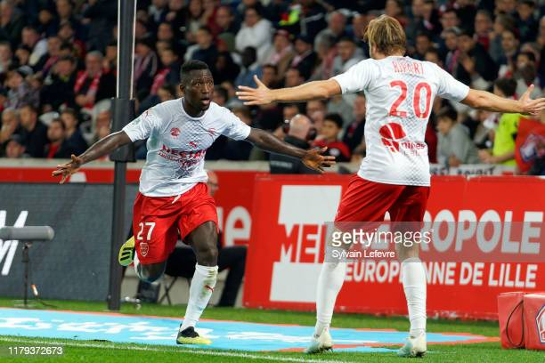 Nimes' Ahoueke Steeve Kévin Denkey celebrates with team mate after scoring goal during the Ligue 1 match between Lille OSC and Nimes Olympique at...