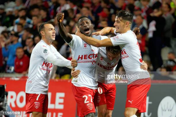 Nimes' Ahoueke Steeve Kévin Denkey celebrates with team mates after scoring goal during the Ligue 1 match between Lille OSC and Nimes Olympique at...