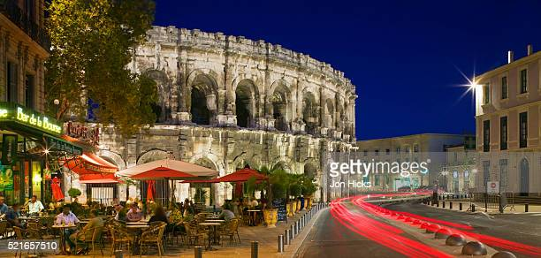 nimes at dusk - nimes stock pictures, royalty-free photos & images