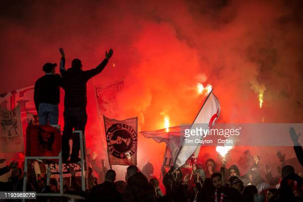 December 14: Nimes fans let off flares during the Nimes V Nantes, French Ligue 1, regular season match at Stade des Costieres on December 14th 2019,...