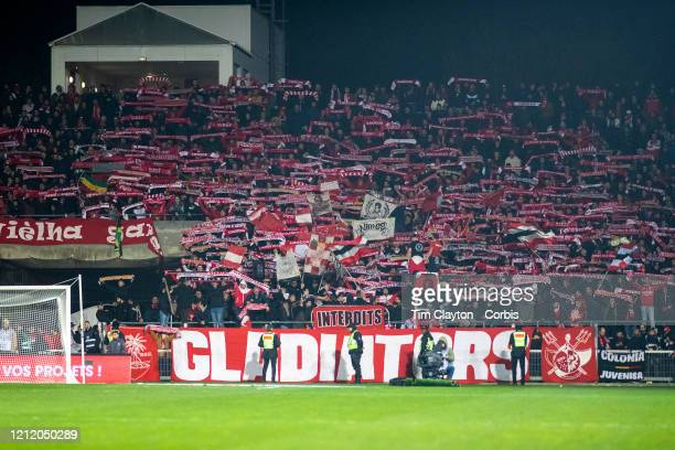 February 28: Nimes fans supporting their team during the Nimes V Marseille, French Ligue 1, regular season match at Stade des Costieres on February...