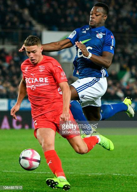 Nimes' French Belgian Baptiste Guillaume vies with Strasbourg's French defender Lamine Kone during the French L1 football match between Strasbourg...
