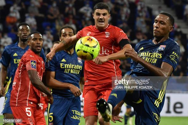Nimes' French defender Anthony Briancon fights for the ball with Lyon's Brazilian defender Rafael Peirera da Silva during the French L1 football...
