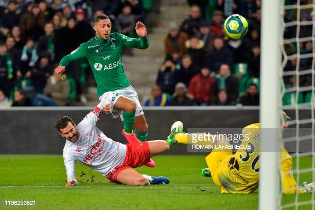 Nimes' French defender Pablo Martinez vies with Saint-Etienne's Gabonese forward Denis Bouanga during the French L1 football match between AS...