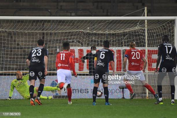 Nimes' French forward Renaud Ripart scores during the French L1 football match between Nimes Olympique and FC Lorient at the Costieres Stadium in...