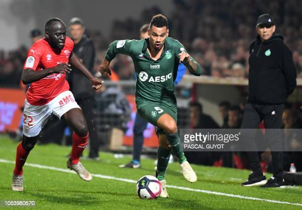 Nimes' French forward Sada Thioub vies with SaintEtienne's French defender Timothee Kolodziejczak during the French L1 football match between Nimes...