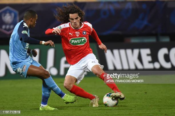Nimes' French midfielder Antoine Valerio vies with Tours' Guinean midfielder Ousmane Balde during the French Cup round of 64 football match between...