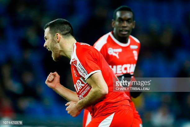 Nimes' French midfielder Antonin Bobichon celebrates after scoring during the French League Cup football match between Le Havre and Nimes on December...