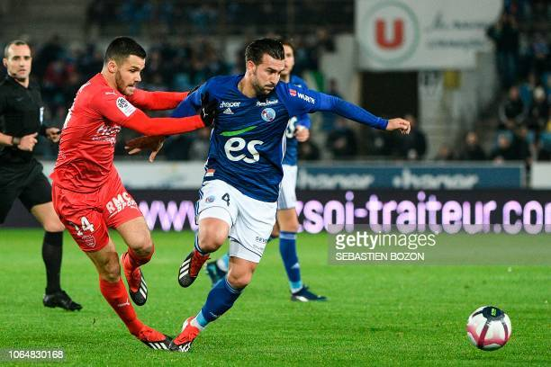 Nimes' French midfielder Antonin Bobichon vies with Strasbourg's French defender Pablo Martinez during the French L1 football match between...