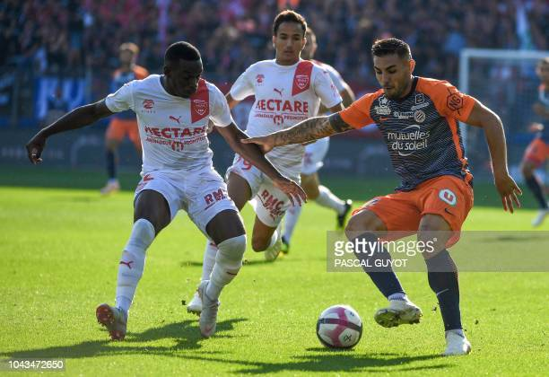 Nimes' French midfielder Faitout Maouassa vies with Montpellier's French forward Andy Delort during the French L1 football match between Montpellier...
