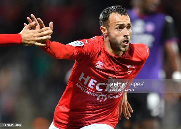 Nimes' French midfielder Romain Philippoteaux celebrates after scoring a goal during the French L1 football match between Nimes and Toulouse on...