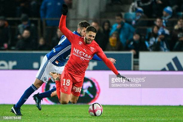 Nimes' French midfielder Theo Valls vies with Strasbourg's French midfielder Benjamin Corgnet during the French L1 football match between Strasbourg...