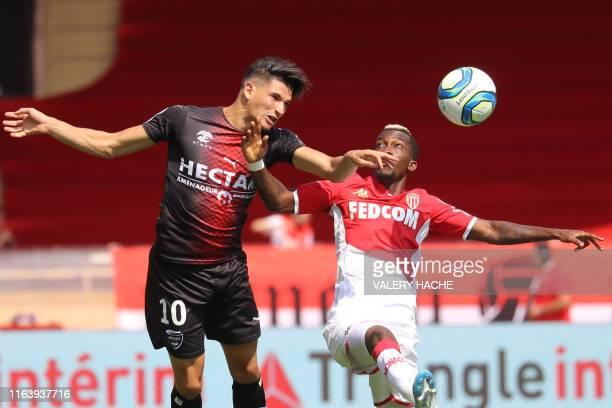Nimes' French midfielder Zinedine Ferhat vies with Monaco's Nigerian forward Henry Onyekuru during the French L1 football match between Monaco and...