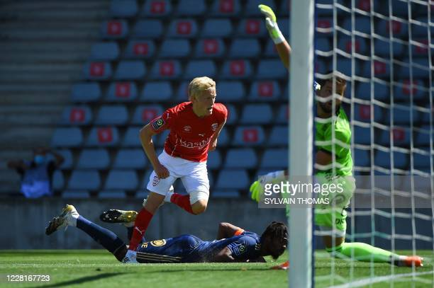 Nimes' Norwegian defender Birger Meling celebrates after scoring a goal during the French L1 football match between Nimes Olympique and Stade...