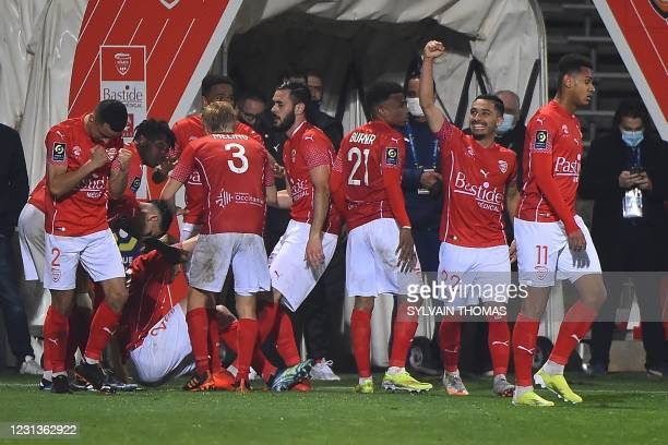 Nimes' players celebrate after scoring during the French L1 football match between Nimes Olympique and FC Lorient at the Costieres Stadium in Nimes,...