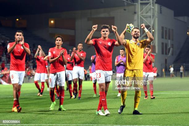 Nimes players celebrate the victory during the Ligue 2 match between Nimes and Le Havre AC at Stade des Costieres on August 25 2017 in Nimes France