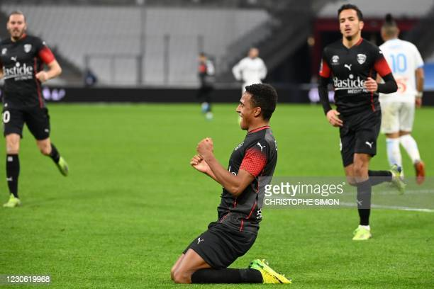 Nimes' Swedish midfielder Niclas Eliasson celebrates his first goal during the French L1 football match between Olympique de Marseille and Nimes...