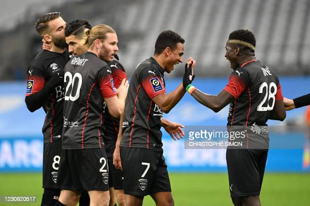 Nimes' Swedish midfielder Niclas Eliasson celebrates his second goal with teammates during the French L1 football match between Olympique de...