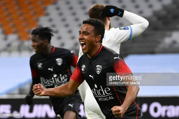 Nimes' Swedish midfielder Niclas Eliasson celebrates his second goal during the French L1 football match between Olympique de Marseille and Nimes...