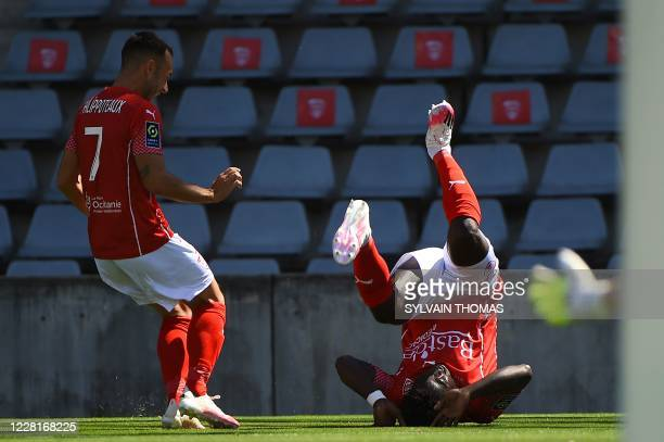 Nimes' Togolese forward Kevin Denkey celebrates after scoring a goal with teammate midfielder Romain Philippoteaux during the French L1 football...