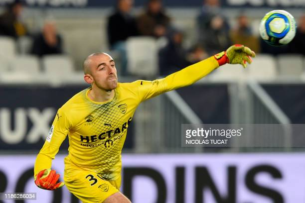 Nimes's French goalkeeper Paul Bernardoni throws the ball during the French L1 football match between FC Girondins de Bordeaux and Nimes at the...